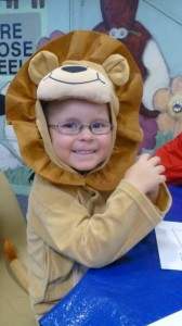 Connor pretended to be a Lion at Storytime