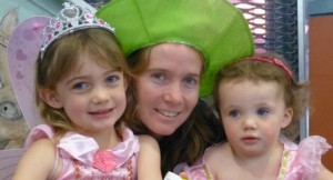  Sienna with mum Amy and sister Ebony dressed up for Storytime