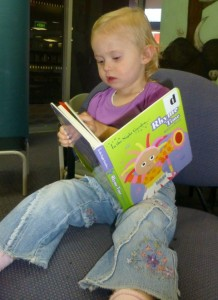 Olivia chooses a book to take home