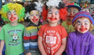 McCallum, Henry, Charlie, Kobe, and Gwen dressed up as clowns for Circus Storytime
