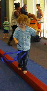 Arden learnt to twirl and balance at the same time at Circus Storytime