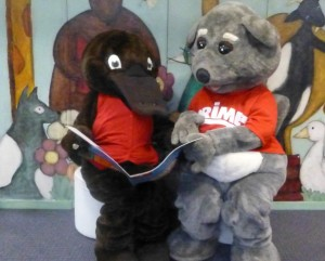 Freeda and Prime Possum read a story together