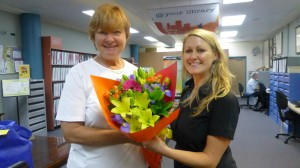 Good Guy of the Week: Home Library Volunteer Jo Krats is congratulated by Tammy