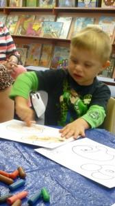 Kody, 4, has fun during craft at Storytime