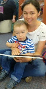 Lucy reads with Hamish age 2, before Storytime starts at 11am