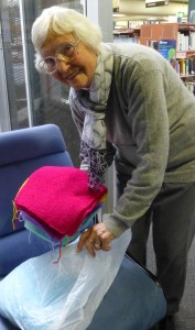 Pauline helps pack bags of donated squares