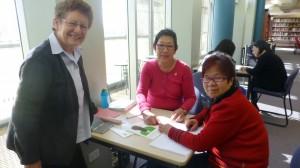 Volunteer Corrine helps Mei with Carmel looking on