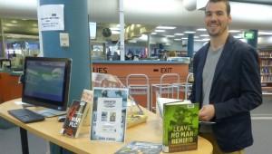 Author Hugh O'Brien checks out military books