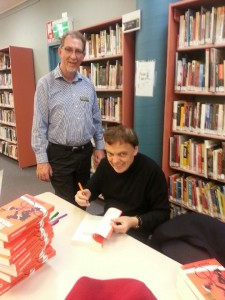 Peter Douglass chates with author Graeme Simsion