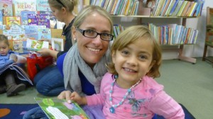 Lisa-Mari reads with her Mum at Storytime