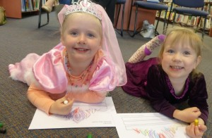 Gracie and Ave coloured in their own tiaras