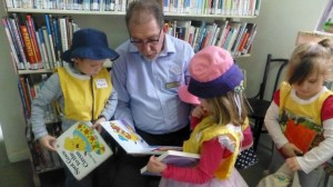 Peter reads with Tyrone, 4,  and Matilda, 4 at Forbes Library