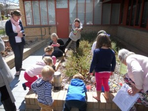 Adding flowers to the Storytime Garden