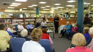 Librarian Trudi updates volunteer knitters