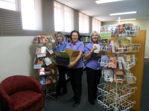 Ann, Caroline and Maryanne sort through books