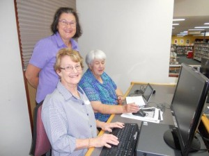 photo of Caroline helping Val and Ruth at the Tech Savvy Seniors class today. There were so many attendees that Michael was run off his feet. Tablets were brought along by some of the students today which proved challenging. Ruth learnt about tabs and the picture folder on hers. Another student learnt about social media . Two of our elderly gents shut down and rebooted the PC successfully a number of times, also managing to find their tabs and searches with little assistance. Another gent found out about passwords, security and choices of devices to suit his needs. Regards Caroline Caroline Eisenhauer Branch Librarian Cowra Library