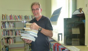 Peter with another stack of books