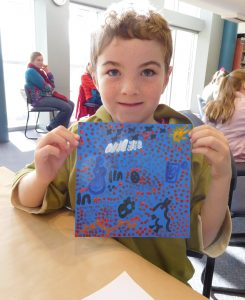 Campbell shows off his dot painting