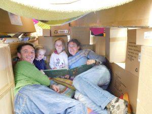 Mark, Millie, Tessa and Birgitte inside their cubby house